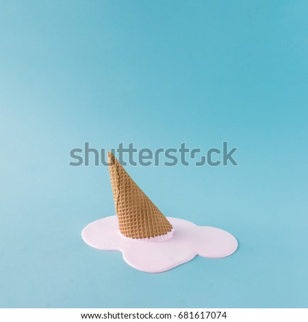 Overhead pink ice cream on pastel blue background. Minimalistic summer food concept. #681617074