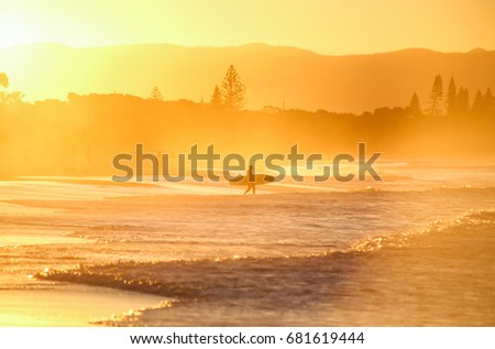 Surfer get into the water at The Wreck, Byron Bay #681619444