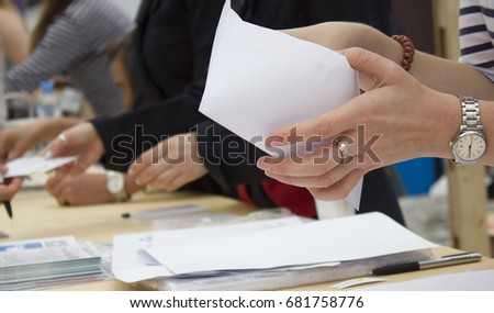 a long table with papers, female hands #681758776
