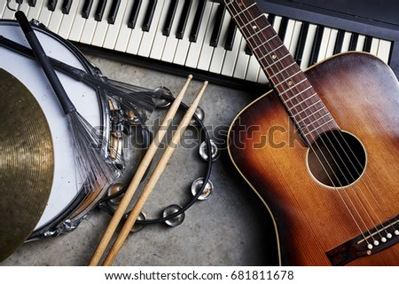 a group of musical instruments including a guitar, drum, and keyboard Royalty-Free Stock Photo #681811678