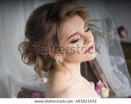 Young sexy girl in white wedding dress. Photo shoot in the photo studio. Beautiful blonde. Bride. #681821692
