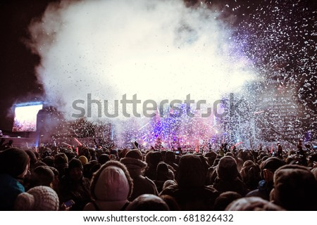 MONTREAL, CANADA - DECEMBER 31, 2016: MERRY MONTREAL - The Coca-Cola New Year's Party under the snow in the old port of Montreal, Quebec, Canada #681826432