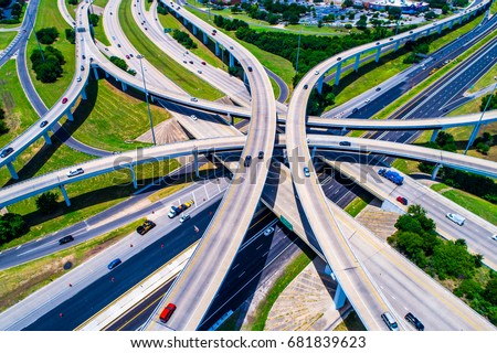 Highway transportation system highway interchange at mopac Expressway and highway 183 in Austin Texas USA summertime green road way interstate #681839623