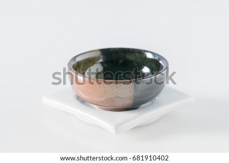 Black cup on white #681910402
