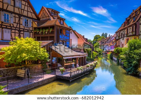 Beautiful view of the historic town of Colmar, also known as Little Venice, traditional colorful houses on idyllic river Lauch in summer, Colmar, Alsace, France #682012942