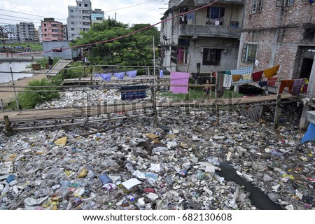 DHAKA, BANGLADESH - JULY 22, 2017: A canal full with wastage and plastic materials in Dhaka, Bangladesh on July 22, 2017. #682130608