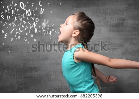 Little girl and letters on grunge background. Speech therapy concept #682205398
