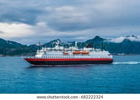 Cruiseship leaving the Svolvaer harbor, Lofoten Islands, an archipelago and a traditional district in the county of Nordland, Norway. Located north of the Arctic Circle.