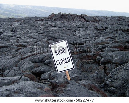 Road buried in lava rock from the eruption of Kilauea, Big Island Hawaii.