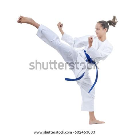 On a white background the sportswoman beats a kick #682463083