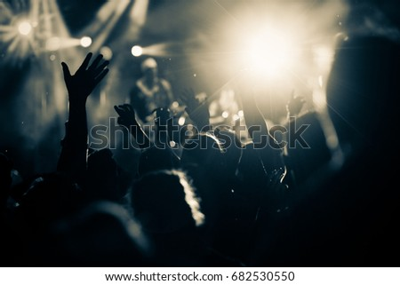 crowd with raised hands at concert - summer music festival #682530550