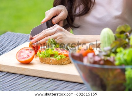 Young beautiful asian woman cooking sandwich with clean food vegetables and fruits for good healthy over green background, healthy food woman for diet  #682615159
