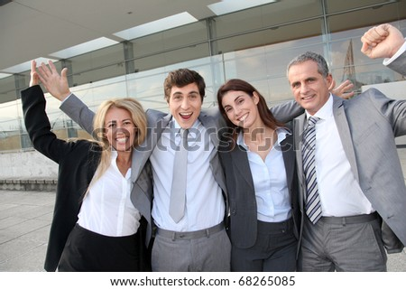Group of happy business people standing outside #68265085