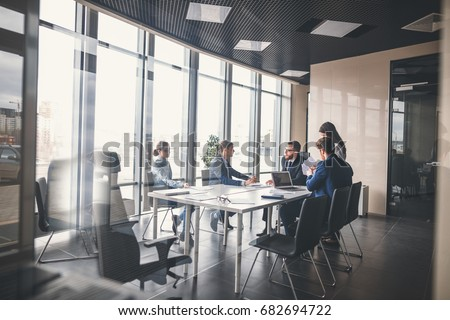 Corporate business team and manager in a meeting Royalty-Free Stock Photo #682694722