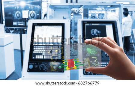 man use the transparent phone with the latest technology with holography and watch the  technology, future and futuristic technology control  Robot welding movement for Industrial automotive #682766779