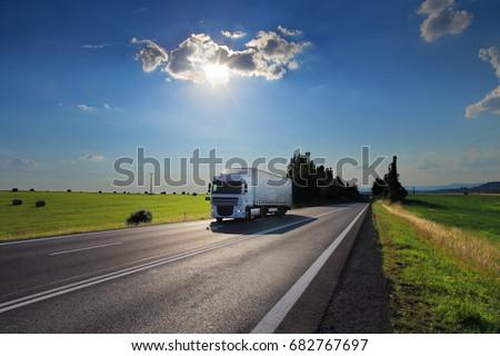 Truck transportation at sunset #682767697