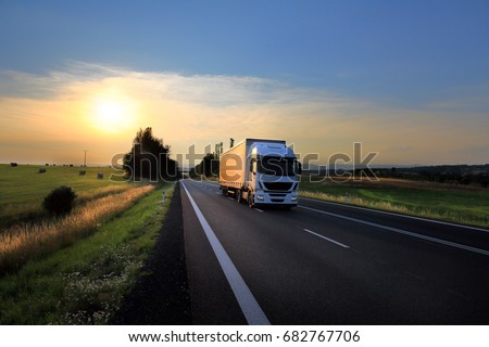 Truck transportation at sunset #682767706