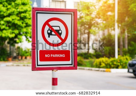 old no parking sign board with blurred background