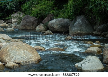 running of water stream from waterfall in tropical rain forest #682887529