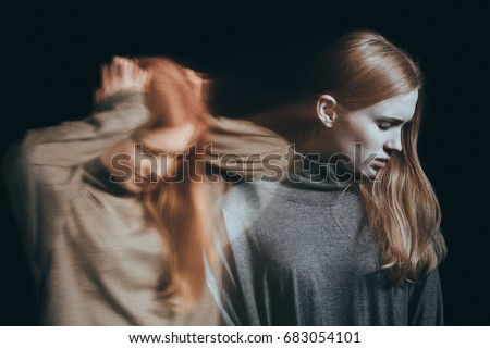 Young teenager with crushing mental illness turning her head away in a depression concept Royalty-Free Stock Photo #683054101