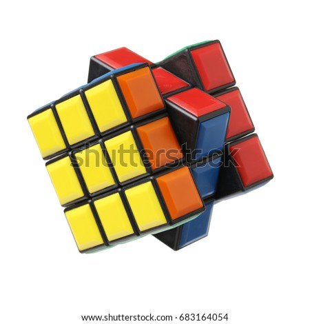 KRAGUJEVAC, SERBIA - DECEMBER 13, 2015: Rubik's 3x3x3 classic cube on a white background. Rubik's Cube invented by a Hungarian architect Erno Rubik in 1974. #683164054