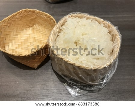 Steamed sticky rice in bamboo box #683173588