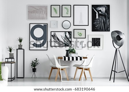 Scandi style dining hall with pictures on the wall Royalty-Free Stock Photo #683190646