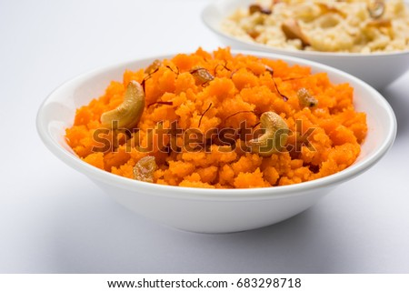 Plain or Saffron flavoured Semolina / Soji Halwa also known as Sweet Rava Sheera OR Shira - Indian festival sweet garnished with dry fruits. Served in a plate or Bowl, selective focus #683298718