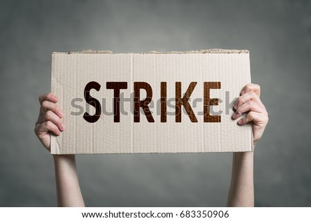 Hands holding protest signs. Workers going on Strike. Royalty-Free Stock Photo #683350906