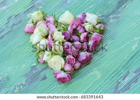 Beautiful heart of flowers roses on green background #683391643