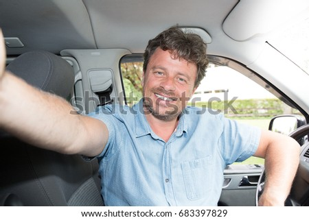 man Driver Smiling Sitting in Driver Seat with make a selfie with smartphone #683397829