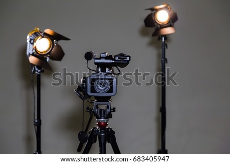 Camcorder and 2 spotlights with Fresnel lenses in the interior. Shooting an interview. #683405947