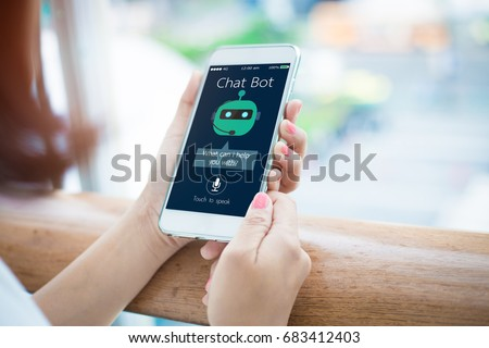 artificial intelligence,AI chat bot concept.close-up of Female hands holding mobile phone #683412403