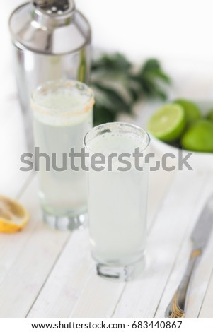 Fresh ginger and lime cocktail with ice    Detox Juice #683440867