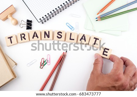 Translate concept. Wooden letters on a white background