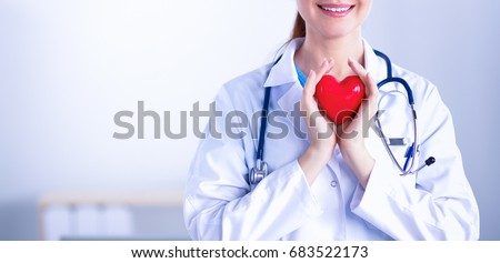 Young woman doctor holding a red heart, isolated on white background Royalty-Free Stock Photo #683522173
