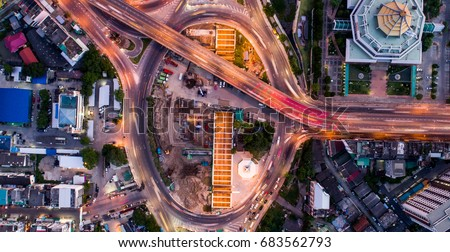 Road beautiful Aerial View of Busy Intersection at Night , top view , thailand . #683562793