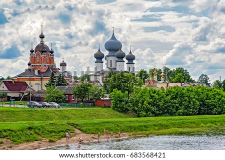 Panorama of Tikhvin orthodox assumption male monastery of the Tikhvin icon of the mother of God on the banks of the Tikhvinka river in Tikhvin, Russia. #683568421