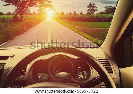 beautiful sunset from the interior of cars in countrysite road #683597722