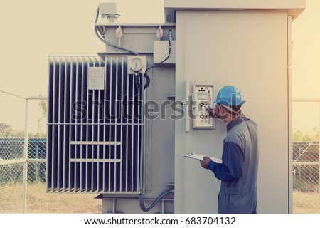 electrician working on checking status step up transformer high voltage on transformer yard and solution problem to operate at green energy solar power plant #683704132