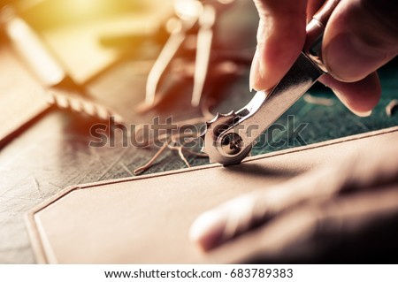 Working with vegetable tanned leather. Leather and the craft tools. Royalty-Free Stock Photo #683789383