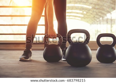 Fitness training with kettlebell in sport gym with sunlight effect. #683798215