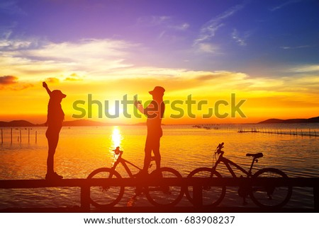 silhouette  Mountain bike and love couple in  the holiday on sunrise time #683908237