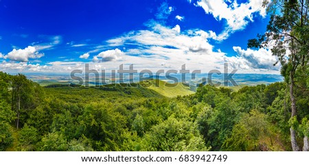 Panorama of amazing summer mountains countryside under blue sky with white clouds #683942749