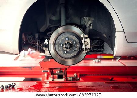 car brake part at garage,car brake disc without wheels closeup Royalty-Free Stock Photo #683971927