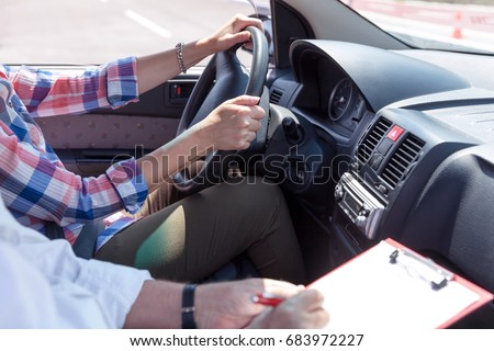 Learner driver student driving car with instructor #683972227