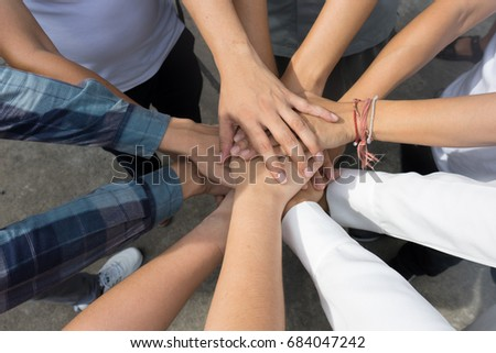 Team work concept. Business people joining hands #684047242