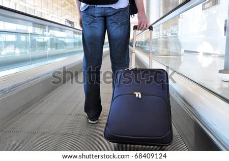 Traveller on the speedwalk #68409124