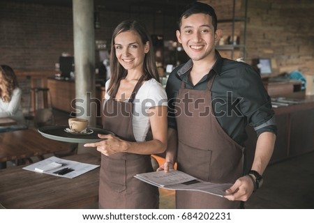 Successful small business owner or waitress proudly standing in front of their cafe or coffee shop #684202231
