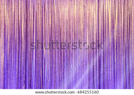 Silver Curtain Screen drape wave and lighting beam around to create colorful change reflection on background #684255160